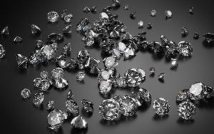 Diamonds on dark grey background. 3D rendering.
